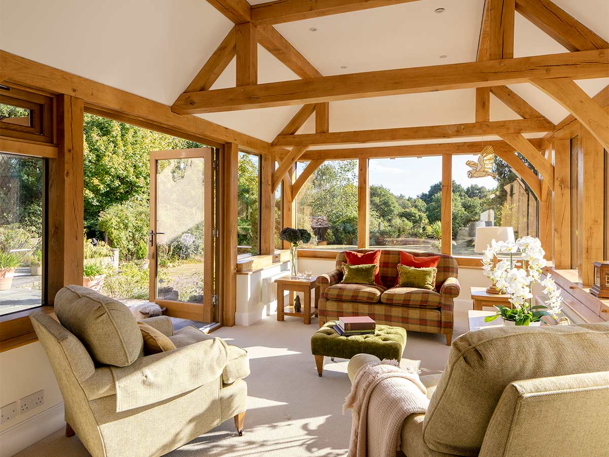 Oak frame orangery extension with face glazing and bi-fold doors