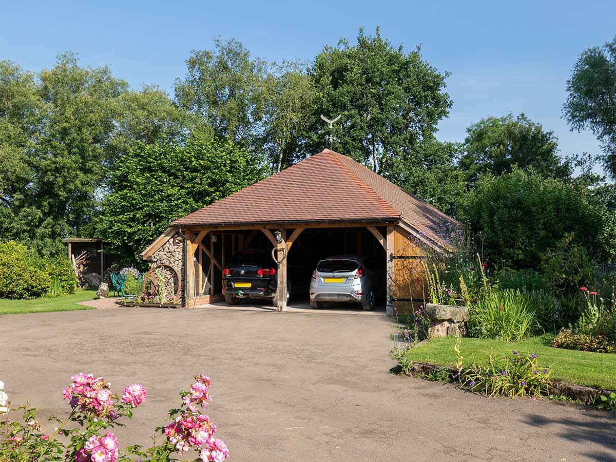 Bespoke oak frame garage in a countryside setting