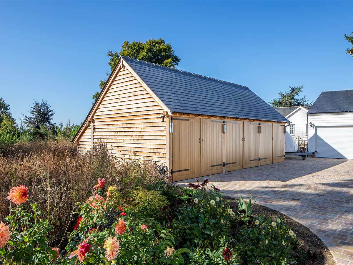 4 bay oak frame garage with a slate roof