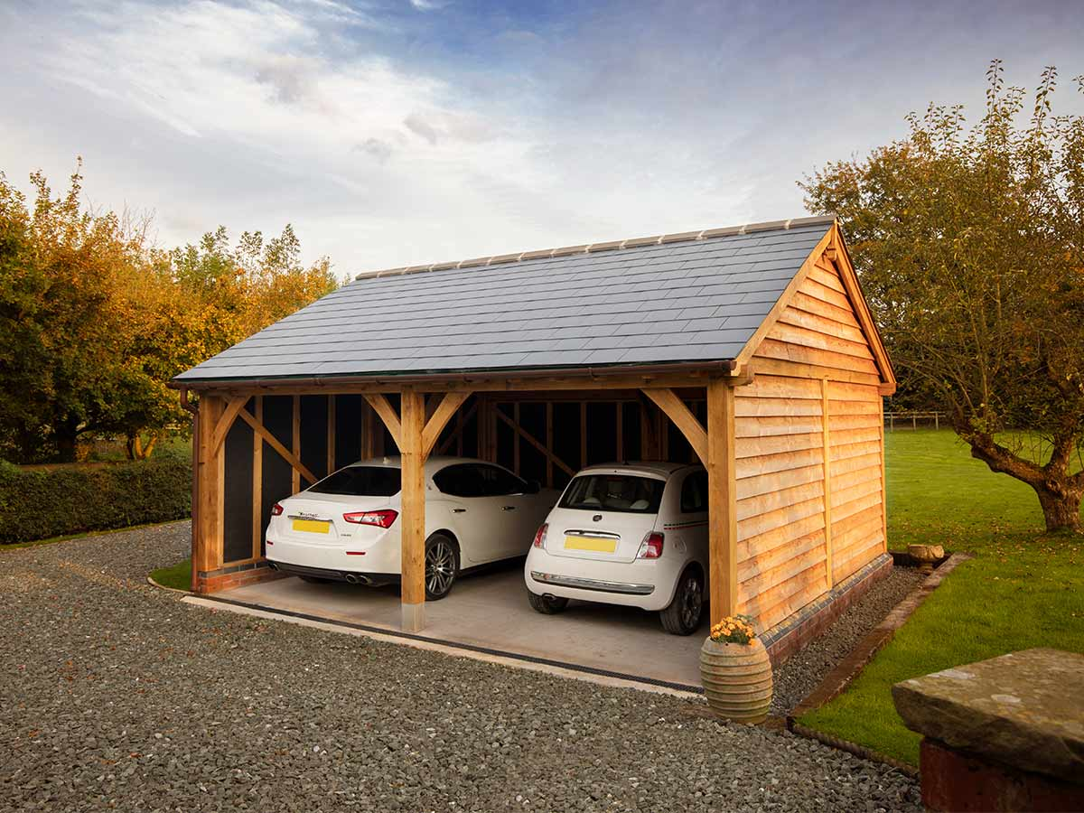 Oak frame garage 'self build kit' with two open bays for parking