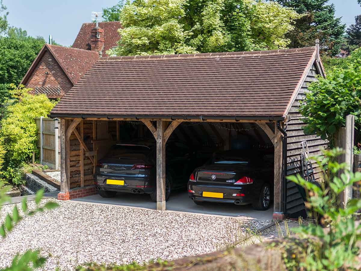 Oak frame garage with two open bays for parking
