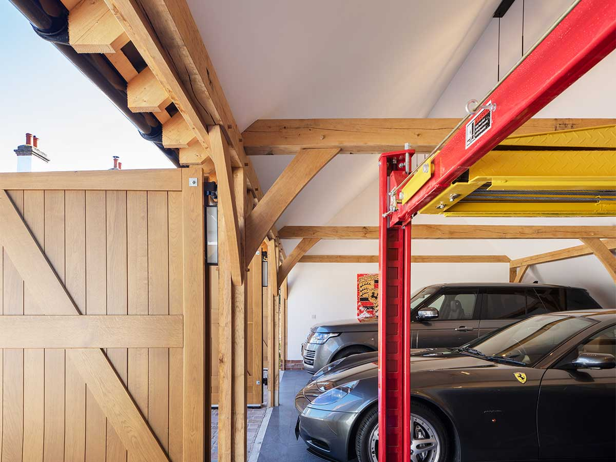 Oak frame garage interior housing a Porche and garage lift